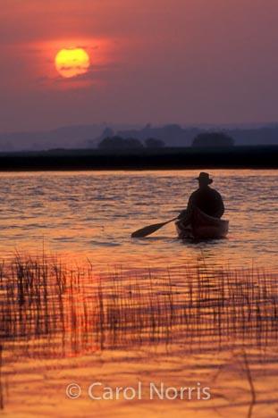 Canada-lake-sunrise-canoeist-lake