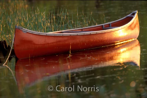 Canada-red-canoe-reflection-water