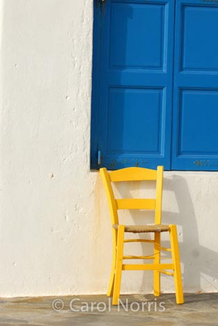 European-Greece-Greek-Island-Mykonos-blue-shutters-yellow-chair