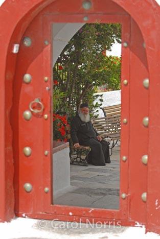 European-Greece-Greek-Orthodox-priest-red-door