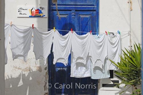 European-vests-shirts-Greece-Mykonos-Greek-Island-blue-door-washing-line