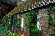 European-Scotland-Britain-stone-cottage-spring-flowers.jpg