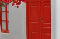 European-Greece-Greek-island-Mykonos-red-door-bougainvillea.jpg