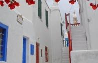 European-Greece-Greek-island-Mykonos-bougainvillea-red-blue-doors.jpg