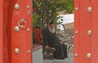 European-Greece-Greek-Orthodox-priest-red-door.jpg