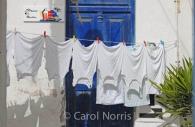 European-vests-shirts-Greece-Mykonos-Greek-Island-blue-door-washing-line.jpg